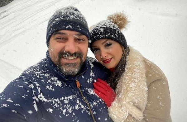 عکس عاشقانه برزو ارجمند و همسرش زیر برف