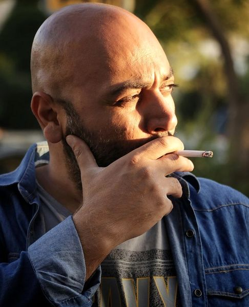 سیگار کشیدن مهدی کوشکی + عکس