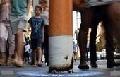 سیگار بزرگ خاموش شده در یک پیادهرو